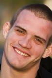 Sourire de jeune homme Image libre de droits
