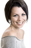 sourire de lancement attrayant de brunette Image libre de droits