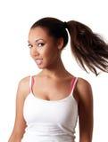 Sourire de oscillation d'arrière de poney de jeune femme de couleur Image stock