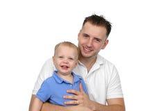 Sourire de père et de fils Photographie stock libre de droits