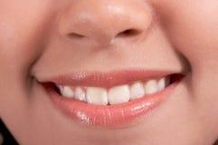 Sourire de plan rapproché Image libre de droits