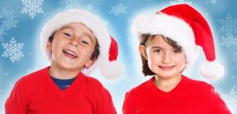 Sourire de Santa Claus de Noël de fille de garçon d'enfants d'enfants heureux image libre de droits