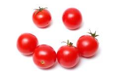 Sourire de tomate sur le blanc Photographie stock libre de droits