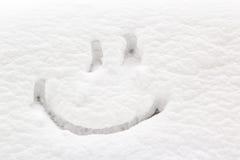 Sourire dessiné sur la neige Photo libre de droits