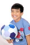 sourire du football de garçon Photo stock