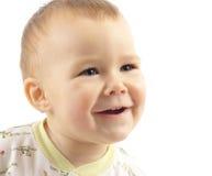 Sourire et pièce mignons d'enfant Photographie stock