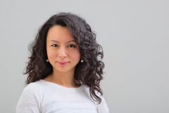 Sourire femelle d'Asiatique Photographie stock