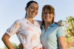 Sourire femelle heureux de golfeurs Photos libres de droits