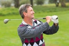Sourire gai de golfeur Images stock
