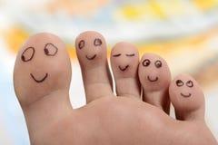 Sourire heureux d'orteils de pieds de pied images libres de droits