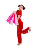Sourire heureux et achats de belle fille de l'Asie Image stock