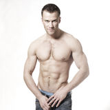 Sourire macho musculaire sexy d'homme Photographie stock