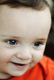 Sourire mignon de garçon. Images stock
