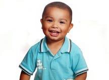 Sourire mignon de sourire de petit garçon image stock