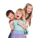 Sourire mignon de trois enfants Images libres de droits