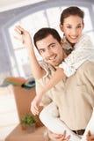 Sourire mobile de maison de couples heureux Photographie stock