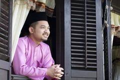Sourire musulman malais d'homme Image libre de droits