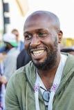 Sourire nigérien heureux de fan de foot images stock