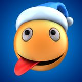 sourire orange de l'émoticône 3d avec le chapeau de Noël Photo stock
