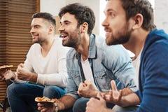 Sourire positif gai d'hommes Photographie stock
