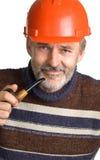 sourire rouge d'hommes de casque de construction Images libres de droits