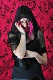 Sourire witchy effrayant de femme Photographie stock libre de droits
