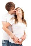 Sourires de caresse de blanc de jeunes couples heureux Images stock