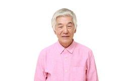 Sourires japonais supérieurs d'homme Photos stock