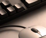 Souris et clavier de sépia Images libres de droits