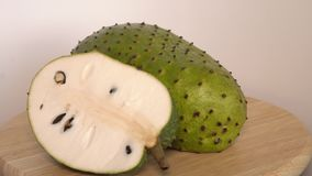 Soursop, Annona muricata L with slice on wooden cutting board