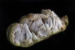 Soursop fruit flesh closeup. On dark background royalty free stock image