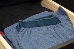 Sous-vêtements masculins dans le tiroir de raboteuse Photo libre de droits