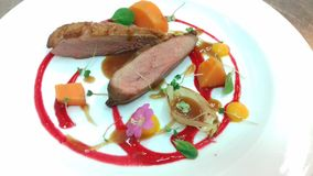 Duck breast sous vide with carrot stock image