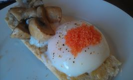 Sous vide egg with fish roe Stock Photography