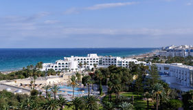 Sousse hotels on the beach, Tunisia. Sousse hotels on the beaSousse hotels (Tunisia) on the beach on a bright sunny day with blue skych, Tunisia royalty free stock photo