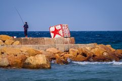 Sousse in Tunisia. Sousse, Tunisia - October 12, 2006: Angler in Sousse also spelled Soussa in Tunisia royalty free stock photos