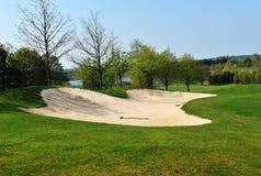 Soute sur un terrain de golf Photographie stock libre de droits