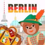 Soutenez à Berlin dans le chapeau de symbole national avec une valise avec le bâton Image stock