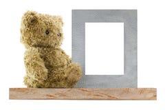 Soutenez se reposer à côté du cadre de tableau vide en métal fait en vrai silv Photographie stock libre de droits