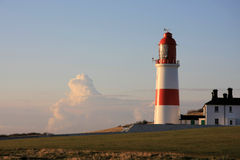 Souter Lighthouse & Cloud. A lighthouse on the North-east coast of England Stock Photo