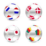 South Africa 2010 - Flags and Balls Group E. Four footballs/soccer balls with the flags of Netherlands, Denmark, Japan and Cameroon - world championship South Royalty Free Stock Photography