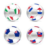 South Africa 2010 - Flags and Balls Group F. Four footballs/soccer balls with the flags of Italy, Paraguay, New Zealand and Slovakia - world championship South Royalty Free Stock Photos
