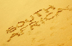 South Africa. The word SOUTH AFRICA in capital letters written in the sand on the beach Royalty Free Stock Photo
