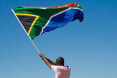 South africa. African man waving a south african flag on beach, new south africa 2010 world cup concept royalty free stock images