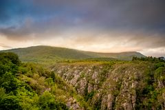 South Africa - Eastern Cape - Storms River. Beautiful canyon view during sunset. Cloudy dusk and rocks showing up Royalty Free Stock Image