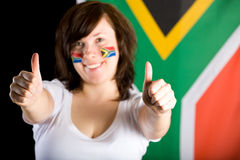 South africa fan, thumbs up, flag as background Royalty Free Stock Photo