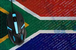 South Africa flag and computer mouse. Digital threat, illegal actions on the Internet royalty free stock images