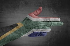 South Africa flag painted on male hand like a gun royalty free stock photos