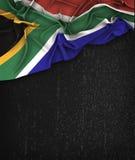 South Africa Flag Vintage on a Grunge Black Chalkboard  Stock Photos