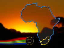 South Africa Football 2010. Outlined Africa with highlighted borders of South Africa in front of an African sunset-landscape - and a football with a tail of the Royalty Free Stock Photography